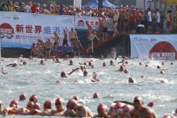New World Harbour Race participants hit the water and swim across Victoria Harbour